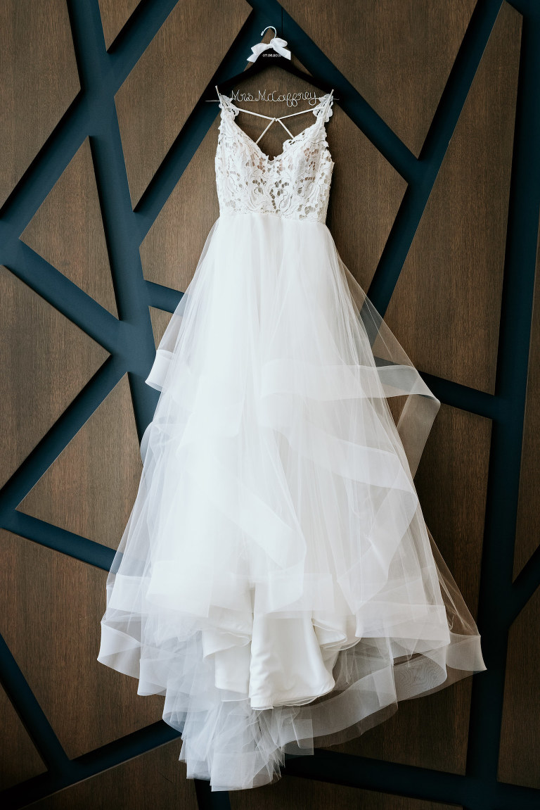 Romantic, Modern White A Line Lace Bodice and Tulle Skirt Wedding Dress Hanging on Art Deco Wall at Hyatt Place Hotel St. Petersburg Downtown | Florida Wedding Photographer Bonnie Newman Creative