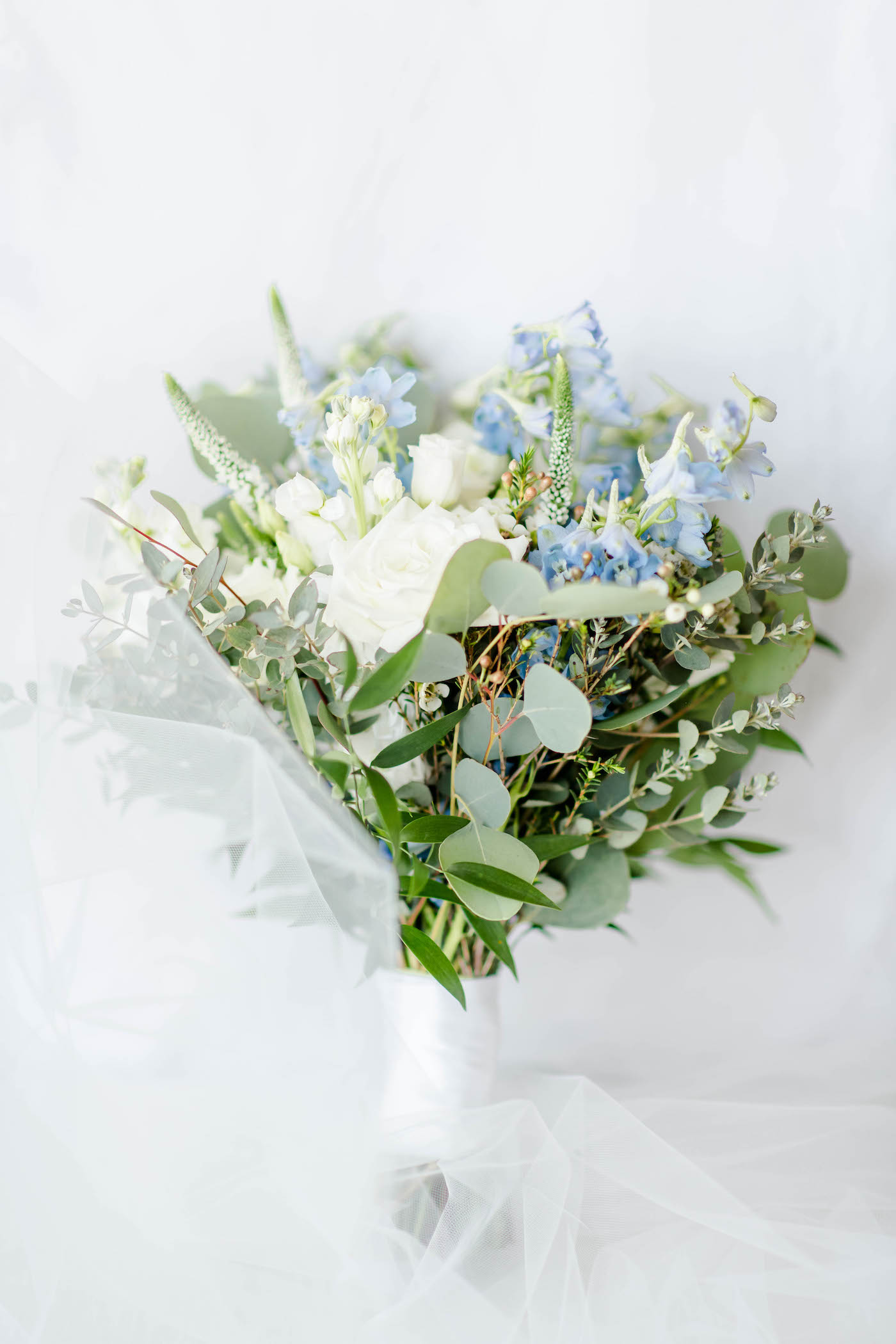 Wedding Bride Bouquet with Eucalyptus Greenery and White Roses and Blue Delphinium