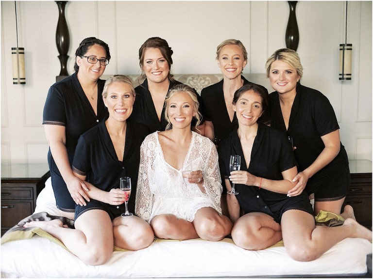 Bride and Bridesmaids Portrait | Bride in Lace Rose and Bridesmaids in Black Pajamas with Champagne in Hotel | St. Pete Wedding Hair and Makeup Femme Akoi Beauty Studio
