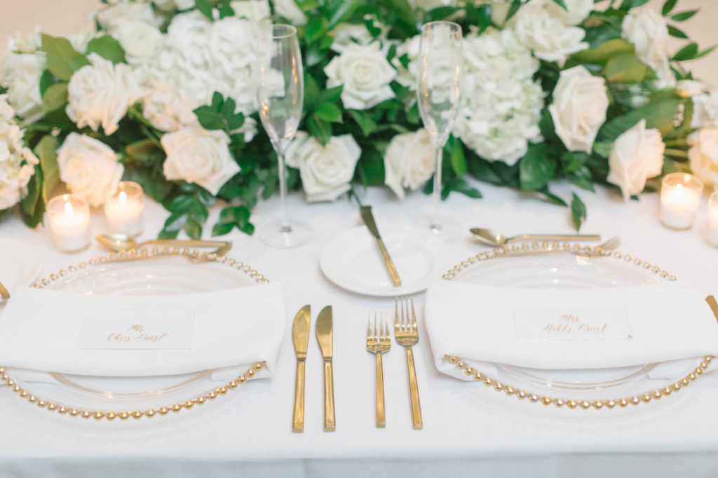 Classic Elegant Wedding Reception Decor, Gold Beaded Rim Chargers, Gold Flatware, White Roses, Hydrangeas and Greenery Lush Floral Arrangement | Tampa Bay Wedding Planner Parties A'la Carte | Wedding Rentals A Chair Affair