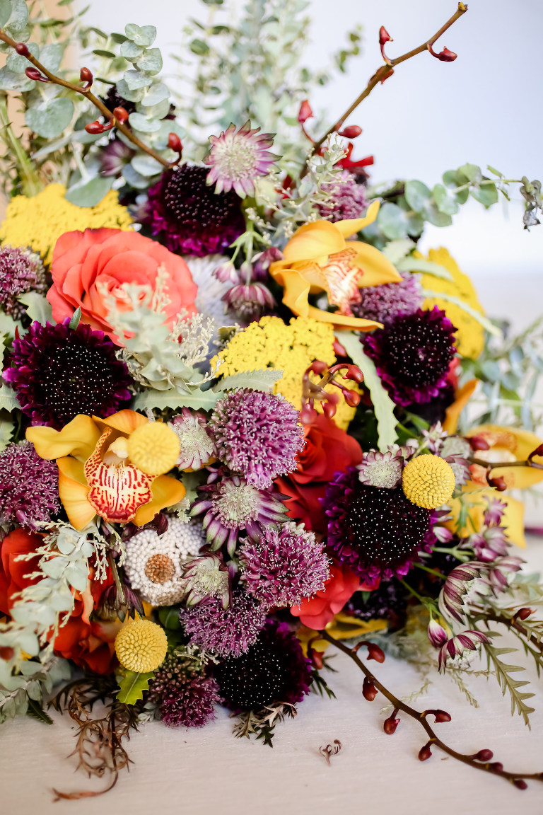 Vintage Bohemian Inspired Florida Wedding Bouquet, Textured Flowers with Orange, Purple, Yellow, Red, Eggplant and Ivory Floral Stems, Thistle, Roses | Tampa Bay Wedding Planner Blue Skies Weddings and Events | Downtown St. Petersburg Wedding Photographer Lifelong Photography Studio