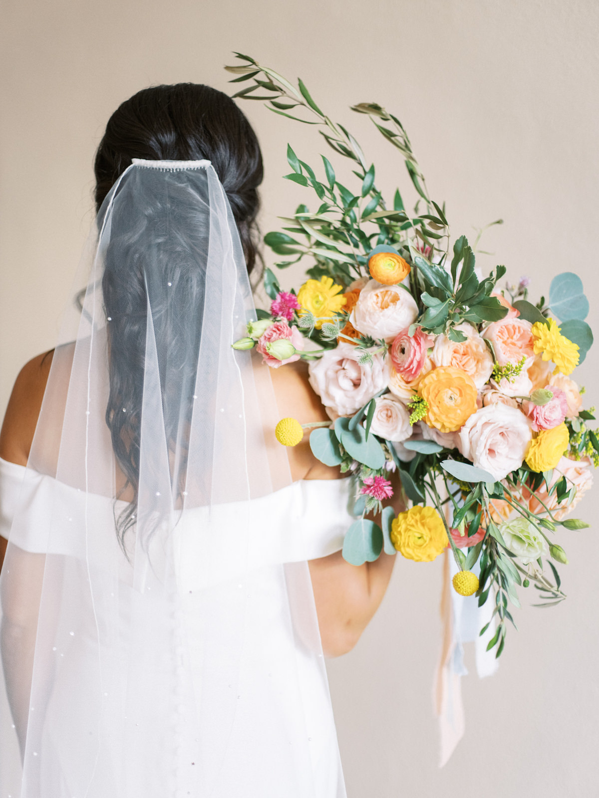 Florida Bride in Sophisticated Off The Shoulder White Wedding Dress with Beaded Veil, Holding Romantic Bridal Bouquet with Vibrant Floral Stems, Pink Roses, Peach Carnations, Yellow Flowers, Light Blue Ribbon Accent, Eucalyptus | Florida Wedding Planner Kelly Kennedy Weddings and Events