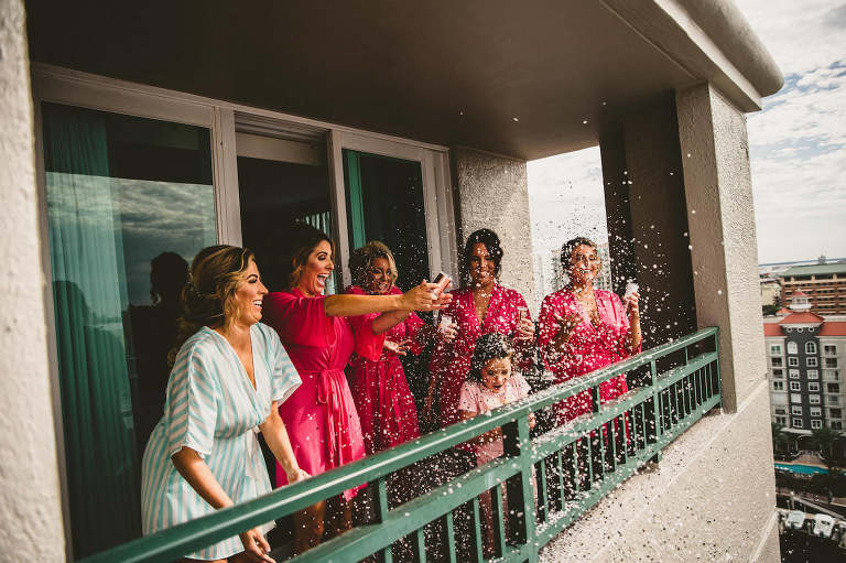 Bride and Bridesmaids Getting Ready and Popping Confetti in Pink Robes