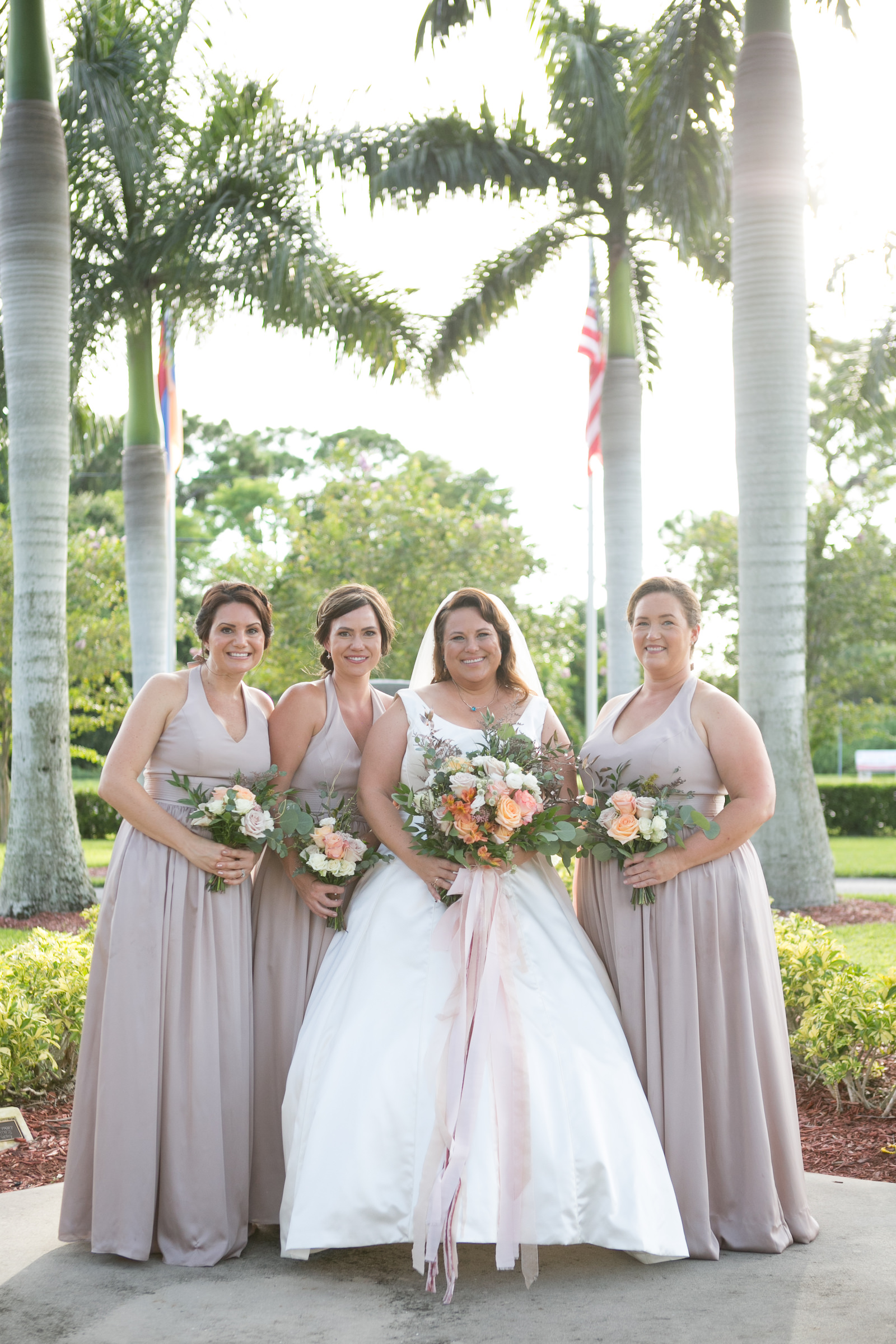 Tampa Bride with Bridesmaids in Matching Biscotti Dresses Holding Greenery and Spring Color Floral Bouquets | Wedding Photographer Carrie Wildes Photography | Wedding Dress Shop Truly Forever Bridal | Wedding Hair and Makeup Michele Renee the Studio