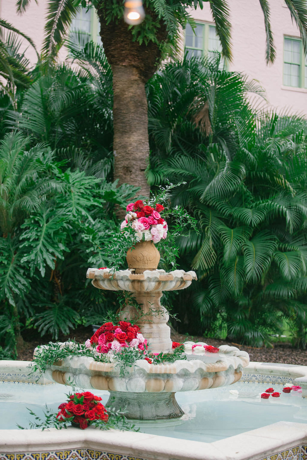 Romantic Wedding Ceremony Decor, Courtyard Water Fountain with Red and Blush Pink Roses   Wedding Florist Bruce Wayne Florals   Wedding Planner Parties A'la Carte