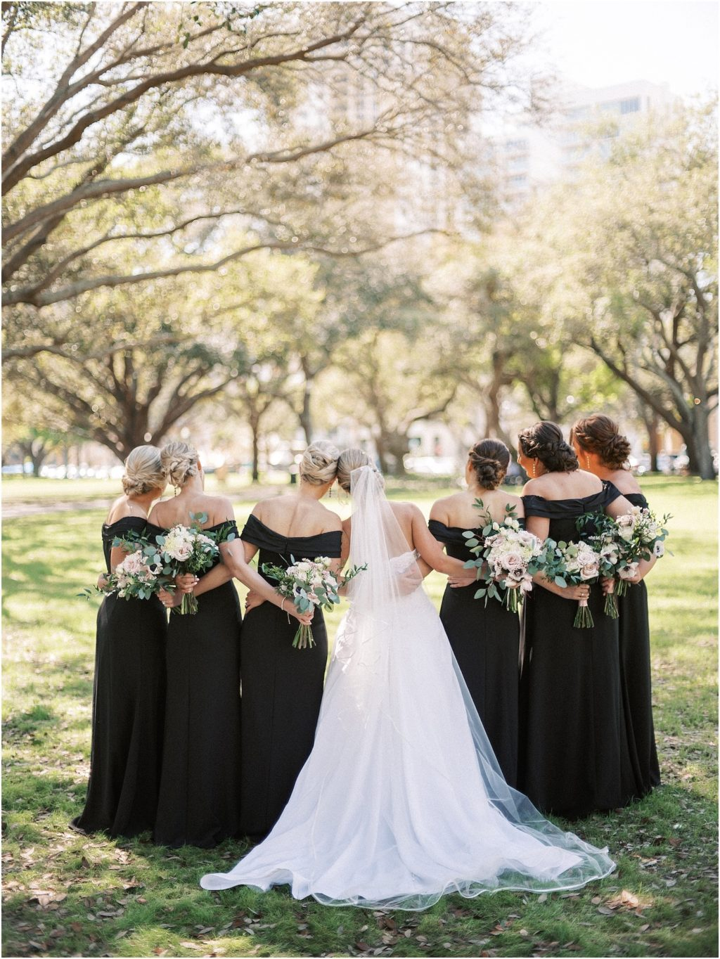Bride and Bridesmaids Outdoor Portraits | Black Long Bridesmaid Dresses with Black and White Anemone and Greenery Bouquets | Tampa Bridesmaids Dress Store Bella Bridesmaids