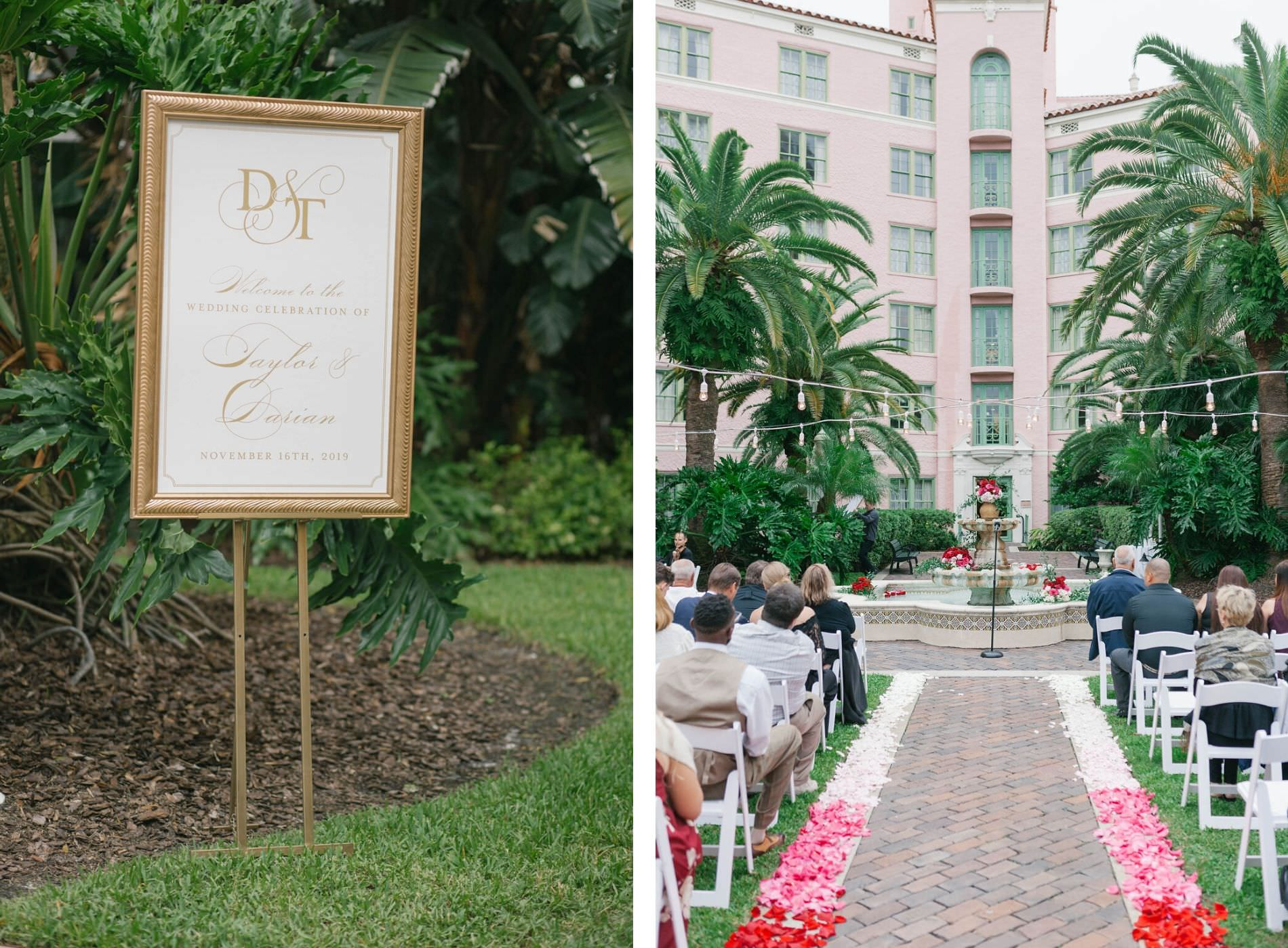 Romantic Wedding Ceremony Decor, Gold Frame Monogram Welcome Sign   Hotel Courtyard with String Lights and Fountain Decorated with Red and Blush Pink Roses and Flower Petals in Aisle   Tampa Wedding Florist Bruce Wayne Florals   Wedding Planner Parties A'la Carte   St. Petersburg Wedding Venue The Vinoy Renaissance