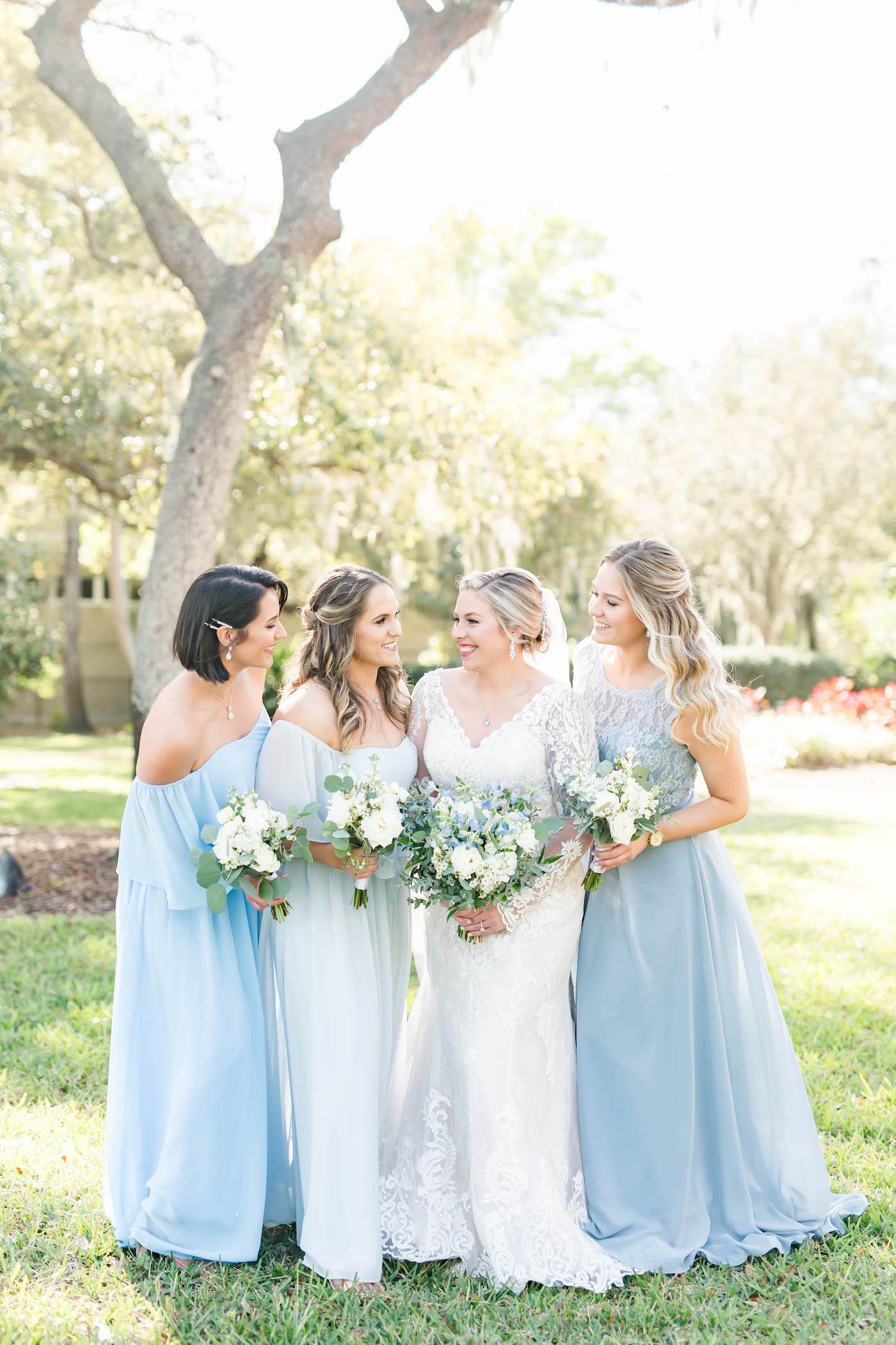 Bride and Bridesmaids Outdoor Garden Portrait   Bridesmaids in Mismatched Light Blue Long Chiffon Dresses   Blue and White Wedding Bouquets   Femme Akoi Beauty Studio