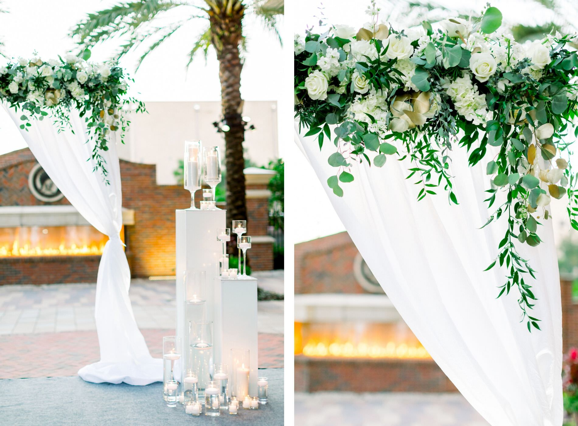 Elegant Classic Wedding Ceremony Decor, White Draped Arch with Greenery and White Roses and Hydrangeas, White Pedestals with Floating Candle Vases, Red Brick Fireplace Backdrop | Wedding Photographer Shauna and Jordon Photography | Tampa Wedding Planner UNIQUE Weddings + Events |