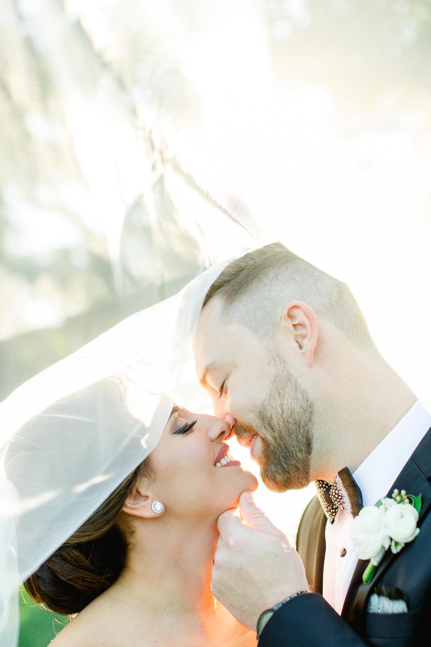 Classic Florida Bride and Groom Wedding Portrait, Intimate Kiss under Bridal Veil