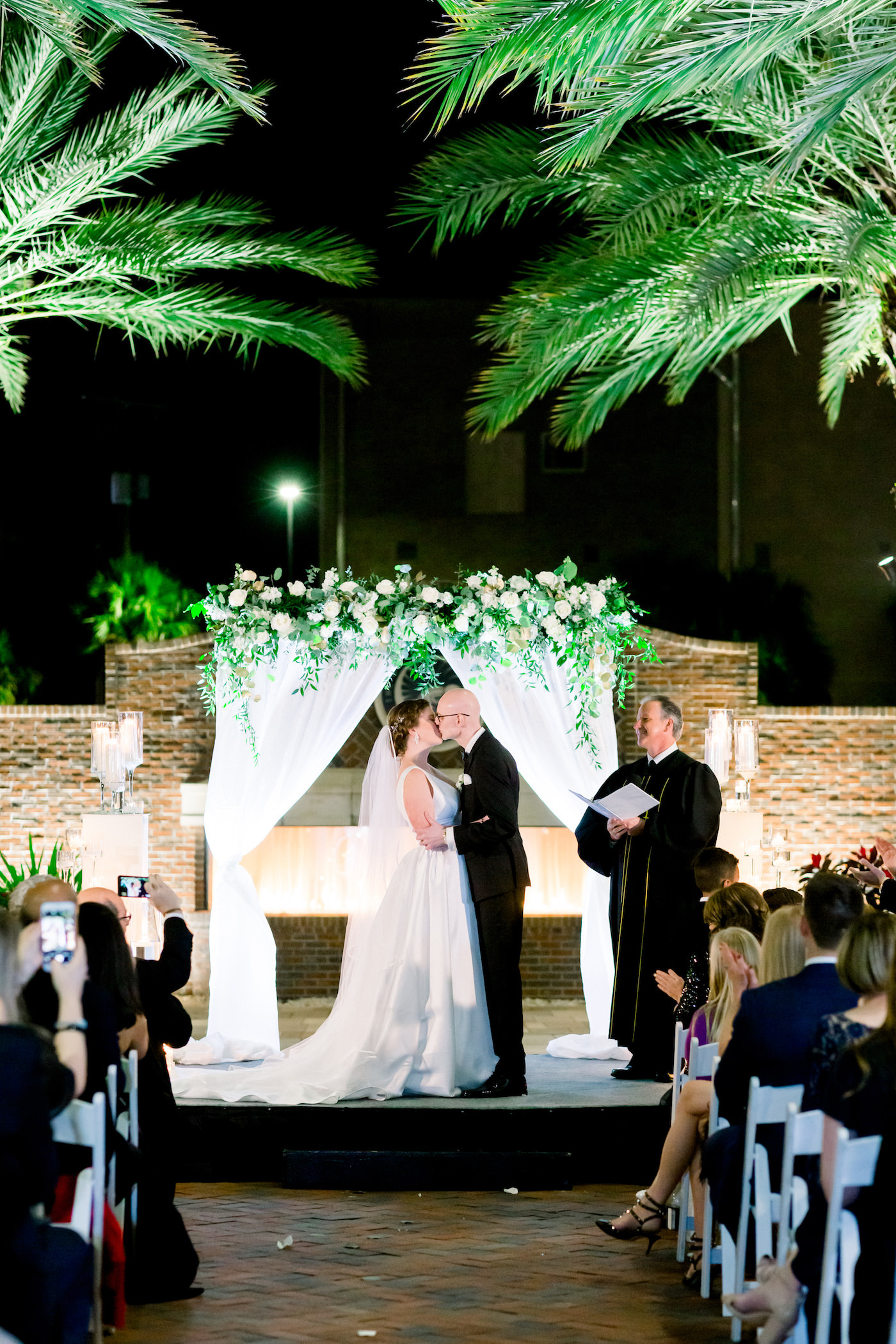 New Year's Eve Nighttime Classic Bride and Groom Wedding Ceremony Portrait in Courtyard at Tampa Agliano Park | Wedding Photographer Shauna and Jordon Photography | Wedding Planner UNIQUE Weddings + Events