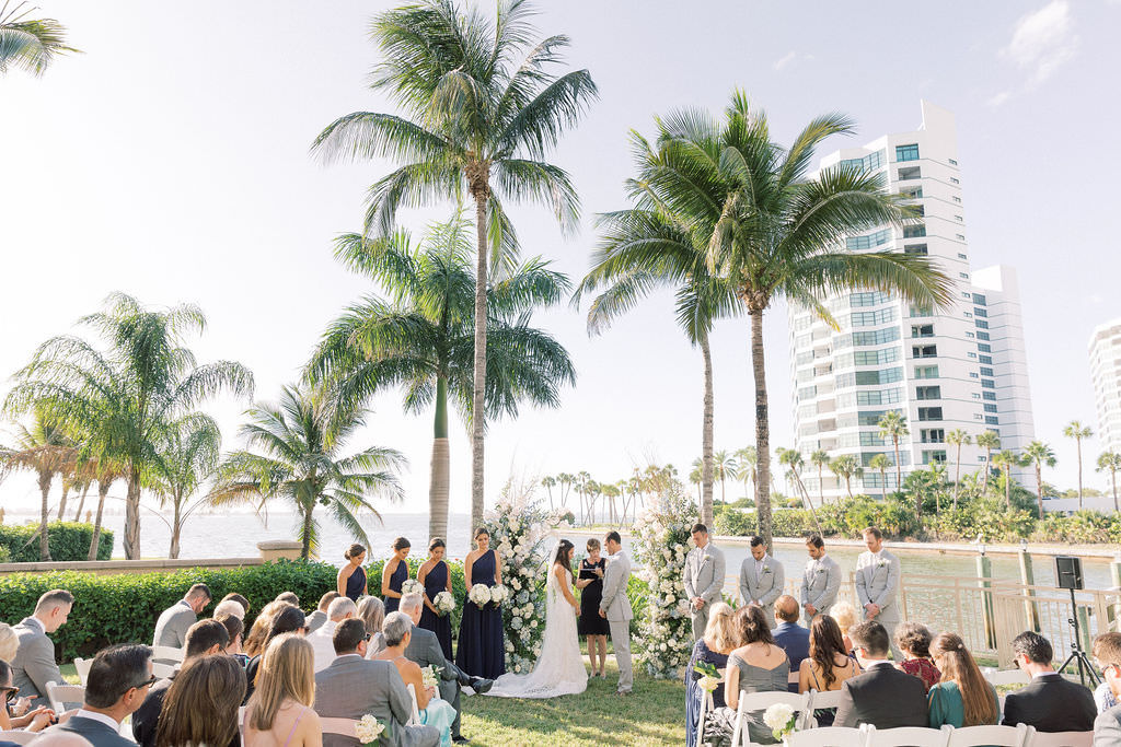 Bride and Groom Exchange Vows in Outdoor Garden Lawn Ceremony at Ritz Carlton Sarasota | Sarasota Wedding Officiant A Wedding With Grace | Florida Destination Wedding Planner NK Productions Wedding Planning