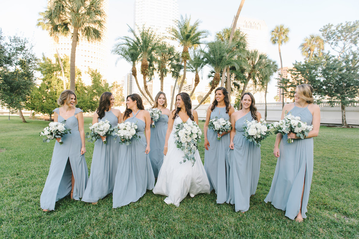 Classic Elegant Florida Bride in A-Line V Neck Wedding Dress with Lush White Roses and Greenery Floral Bouquet, Bridesmaids in Mix and Match Dusty Blue Dresses | Tampa Bay Wedding Photographer Kera Photography