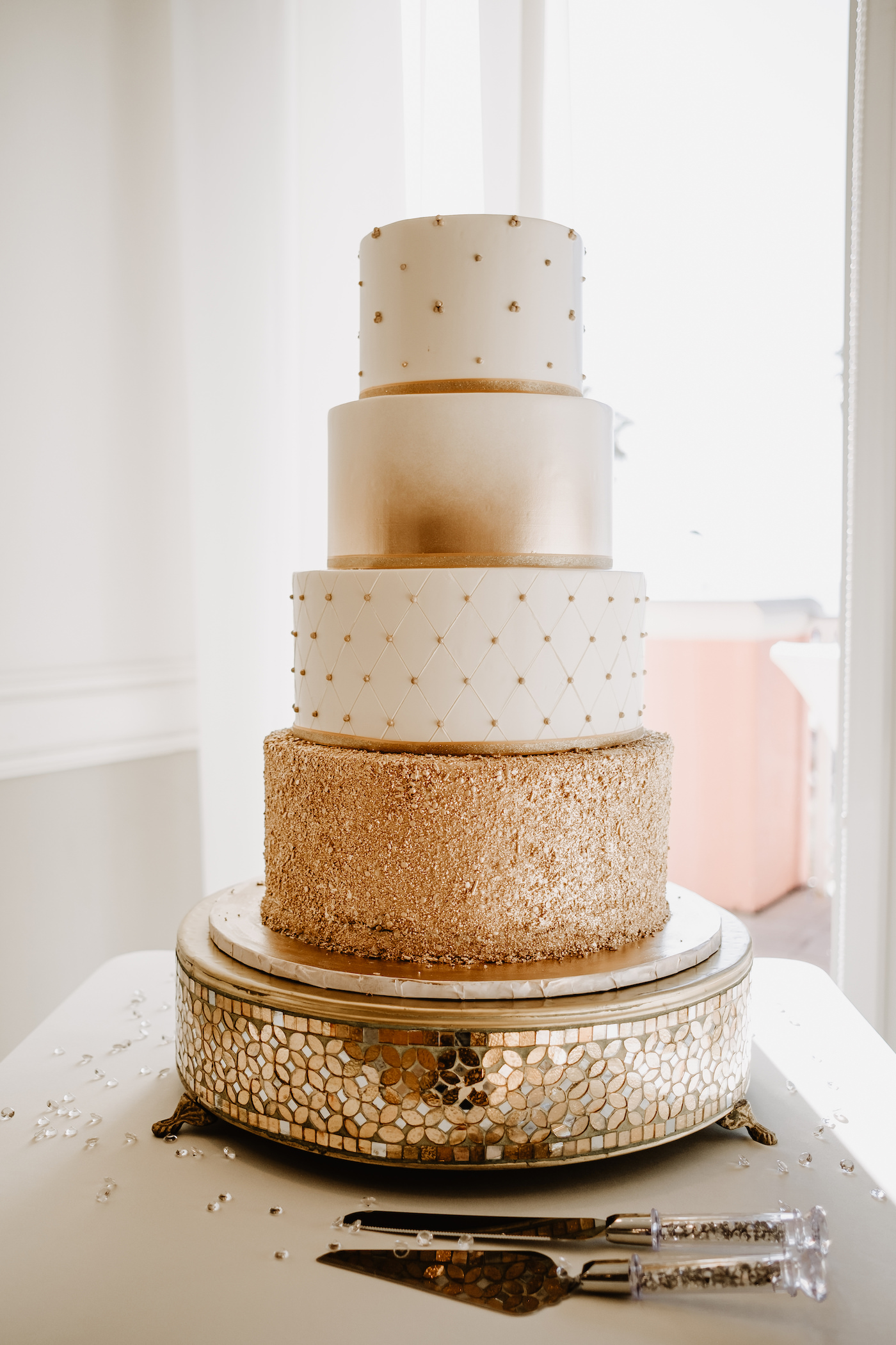 Round Four Tier Wedding Cake with Metallic Gold Embellishments on Ornate Gold Stand   Tampa Cake Bakery The Artistic Whisk