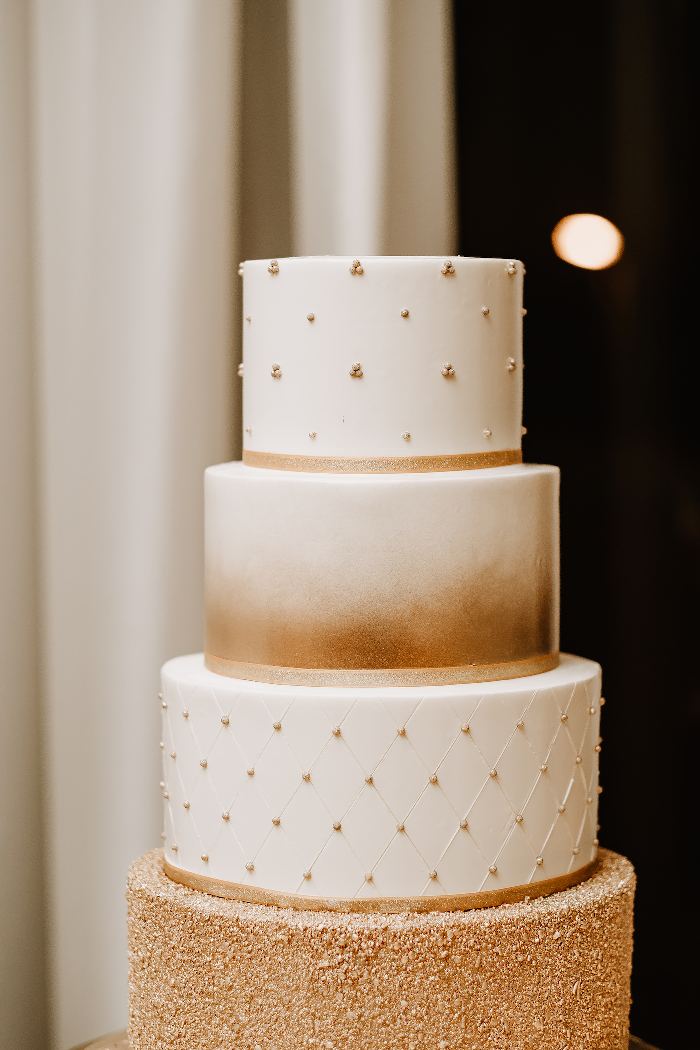 Round Four Tier Wedding Cake with Metallic Gold Embellishment Patterns   Tampa Cake Bakery The Artistic Whisk