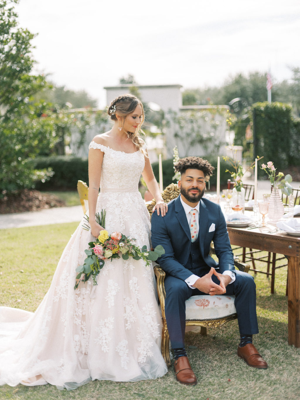 Tampa Styled Shoot European Pastel Spring Wedding Inspiration | Bride and Groom Outdoor Garden Portraits | Lace Ball Gown Wedding Dress and Navy Blue Suit | Sarasota Wedding Dress Boutique Truly Forever Bridal