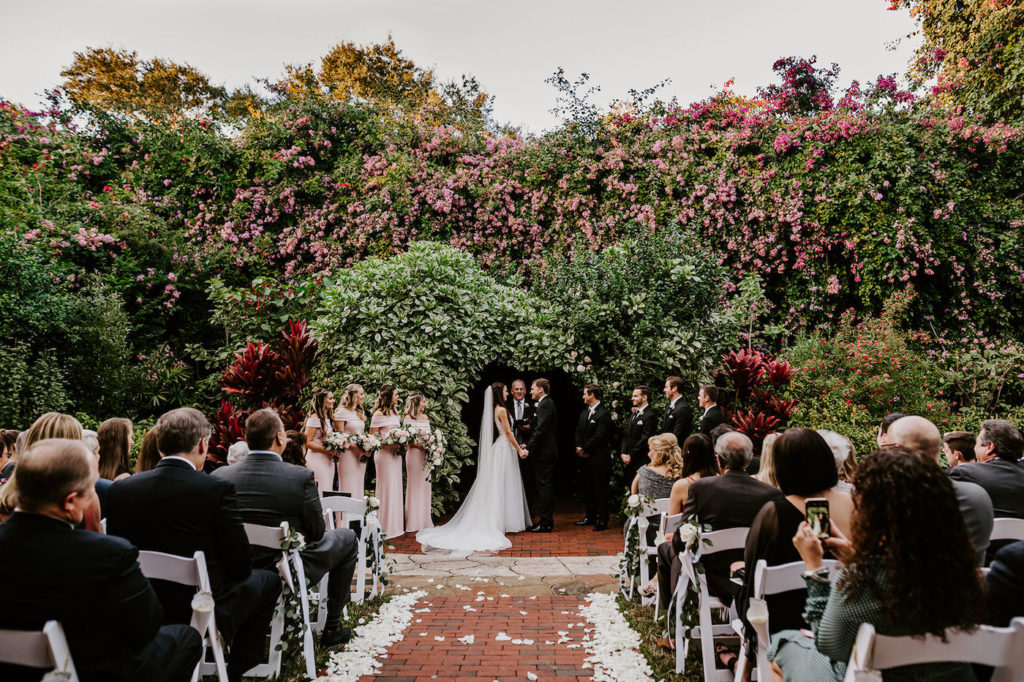St. Petersburg Outdoor Garden Wedding Ceremony with Lush Covered Wall Backdrop | Blush Pink and White Wedding