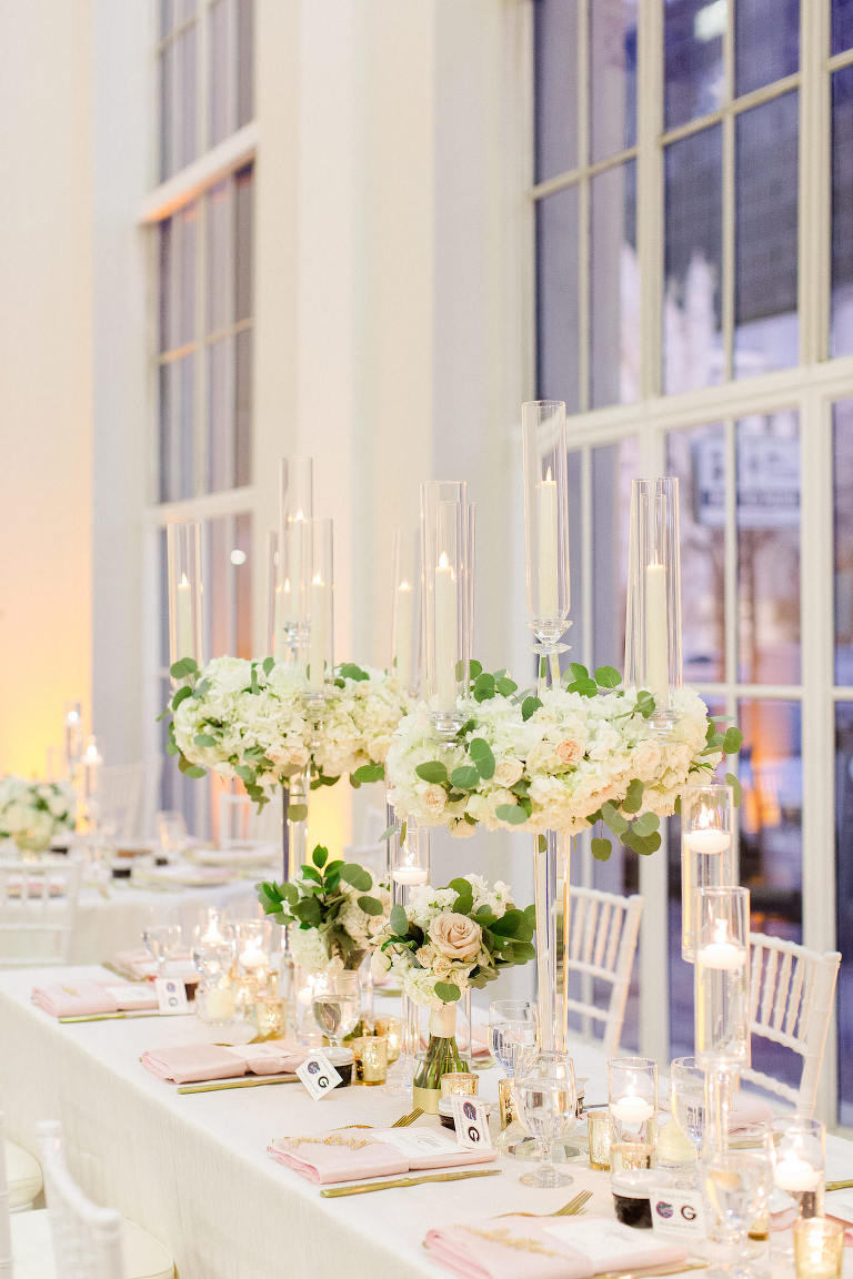 Classic Wedding Reception and Decor, Tall Candelabra Centerpieces with Lush Greenery and Ivory Flowers, Blush Pink Linens, Gold Mercury Glass, White Chiavari Chairs | Downtown Tampa Wedding Venue The Vault | Florida Wedding Planner Breezin' Weddings