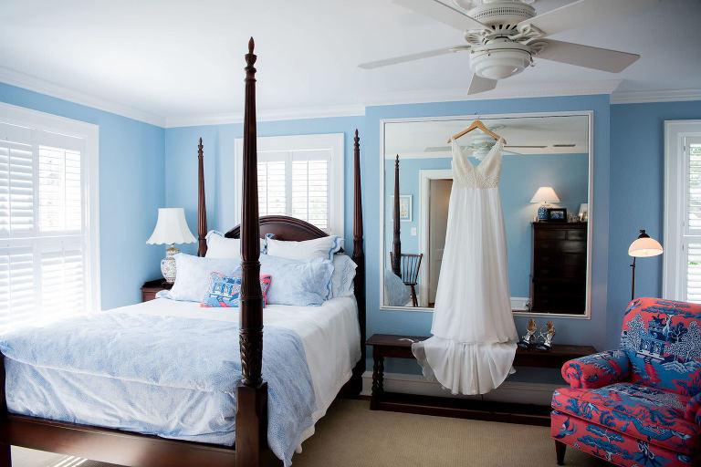 Romantic V Neckline A-Line Wedding Dress Hanging in Hotel Room