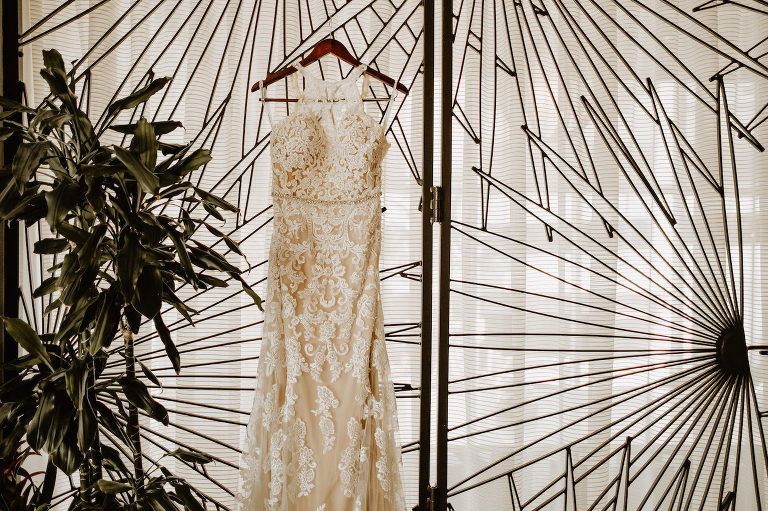 Wedding Dress Hanger Shot | Champagne Lace Sheath Illusion Neck Bridal Gown