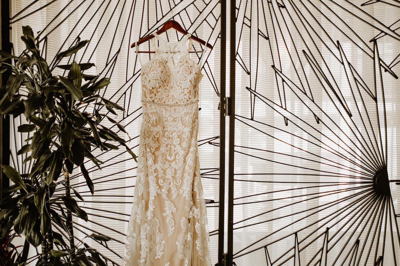 Wedding Dress Hanger Shot   Champagne Lace Sheath Illusion Neck Bridal Gown