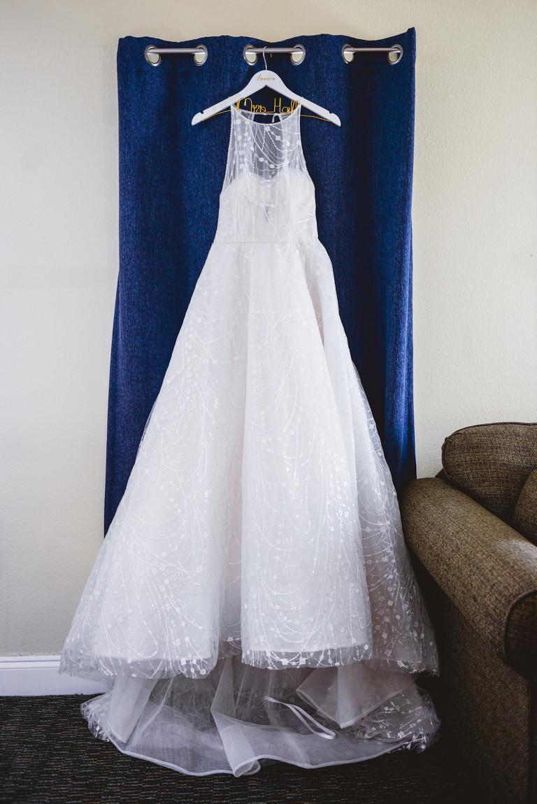 Wedding Dress Hanger Shot   White Embroidered Organza Ballgown Illusion Neck Bib Neckline Bridal Gown   Tampa Wedding Dress Shop Truly Forever Bridal