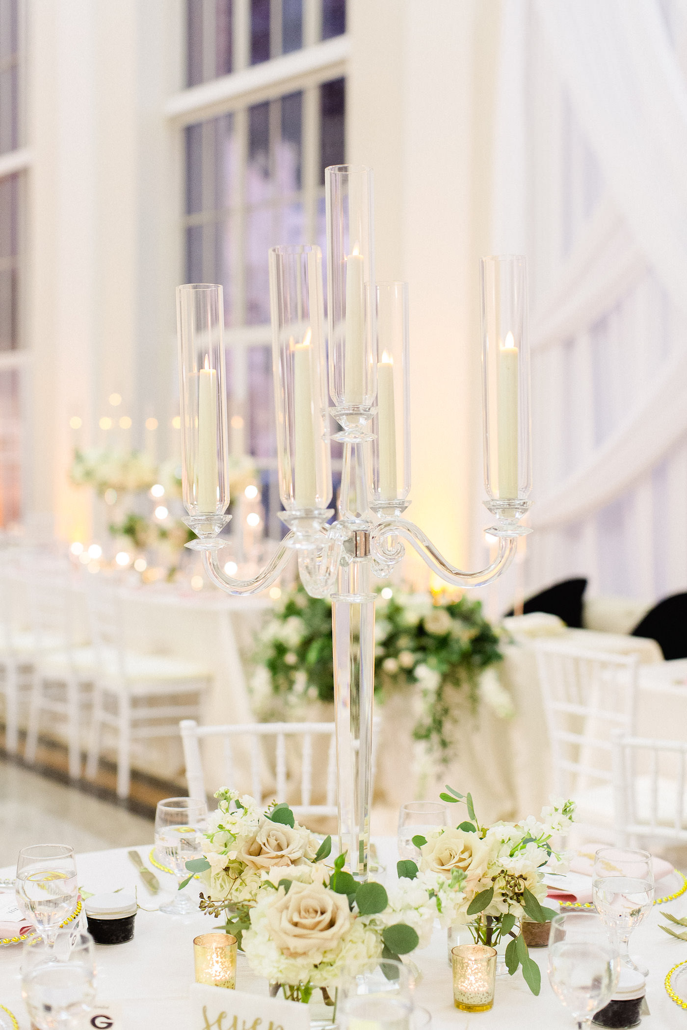 Classic Wedding Reception and Decor, Tall Crystal Candelabra Centerpieces with Greenery, Ivory Flowers, Blush Pink Roses, Gold Mercury Glass, White Chiavari Chairs | Downtown Tampa Wedding Venue The Vault | Florida Wedding Planner Breezin' Weddings