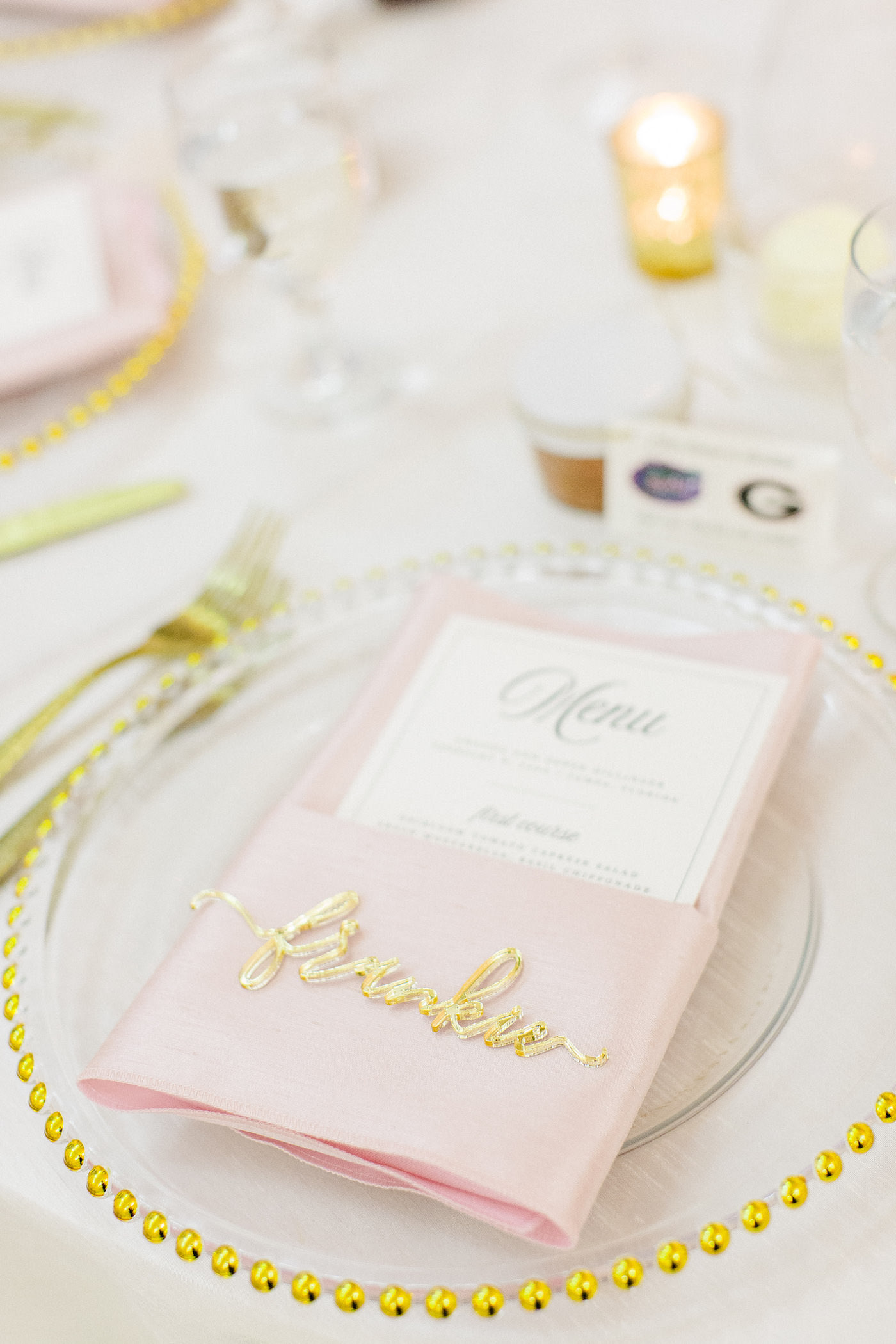 Classic Florida Wedding Reception Table Decor, Clear Glass Charger with Gold Beaded Rim Detailing, Blush Pink Linens with Printed Menu, Gold Laser Engraved Name for Place card | Florida Wedding Planner Breezin' Weddings