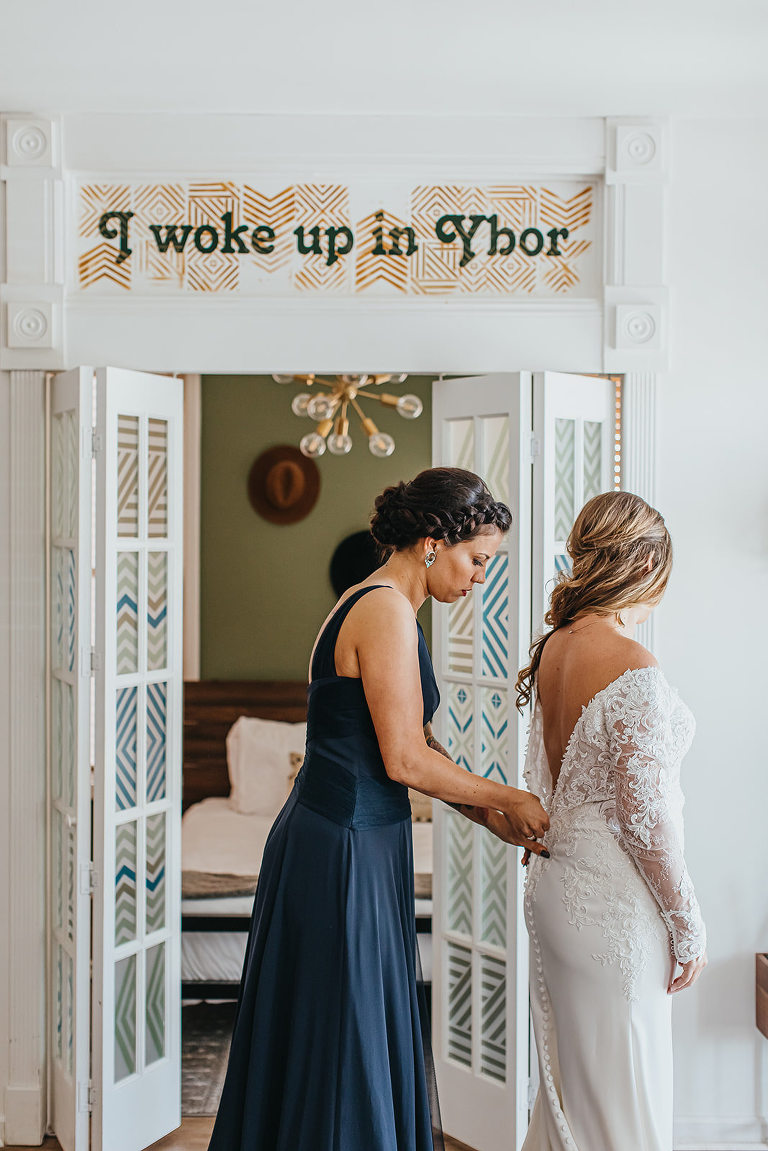 Ybor City Tampa Wedding Bride Getting Dressed | Long Sleeve Lace Wedding Dress Bridal Gown with Low Back and Buttons
