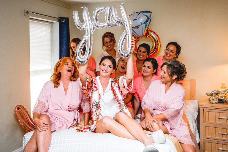 Bride and Bridesmaids Getting Ready in Pink Robes with Wedding Balloons