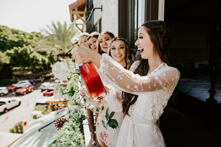 Bride and Bridesmaids Getting Ready and Popping Champange in Hotel | St. Petersburg Wedding Bridal Party