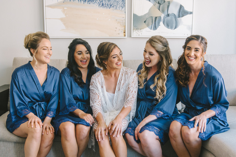 Bride and Bridesmaids Getting Ready in Blue Silk Robes with White Lace Bridal Robe | Tampa Bay Wedding Photographer Kera Photography