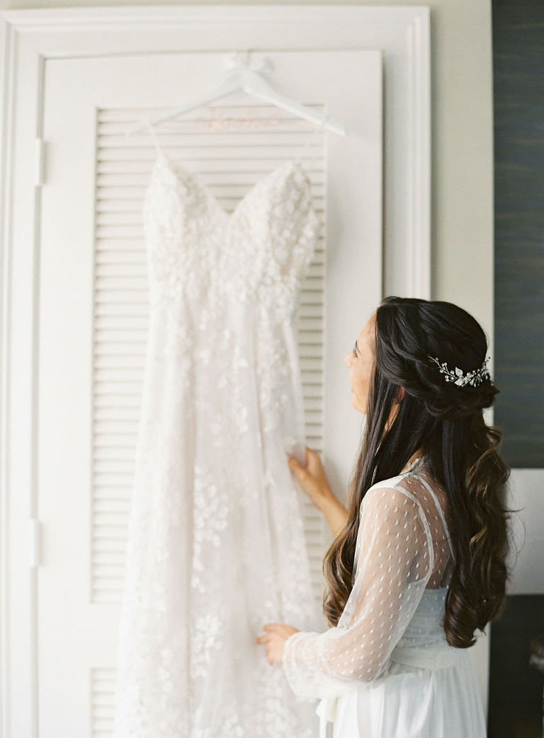 Sarasota Bride Admiring Her Hanging Lace Lazaro Wedding Dress