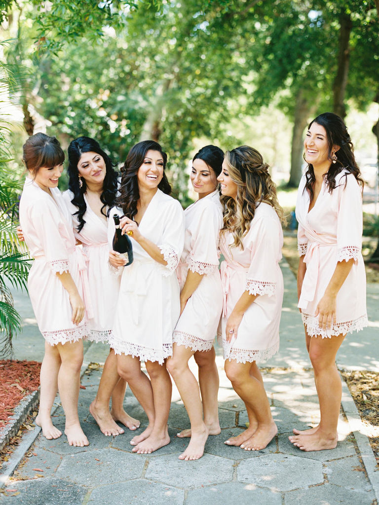 Bride and Bridesmaids Getting Ready and Popping Champagne in Blush Pink Robes