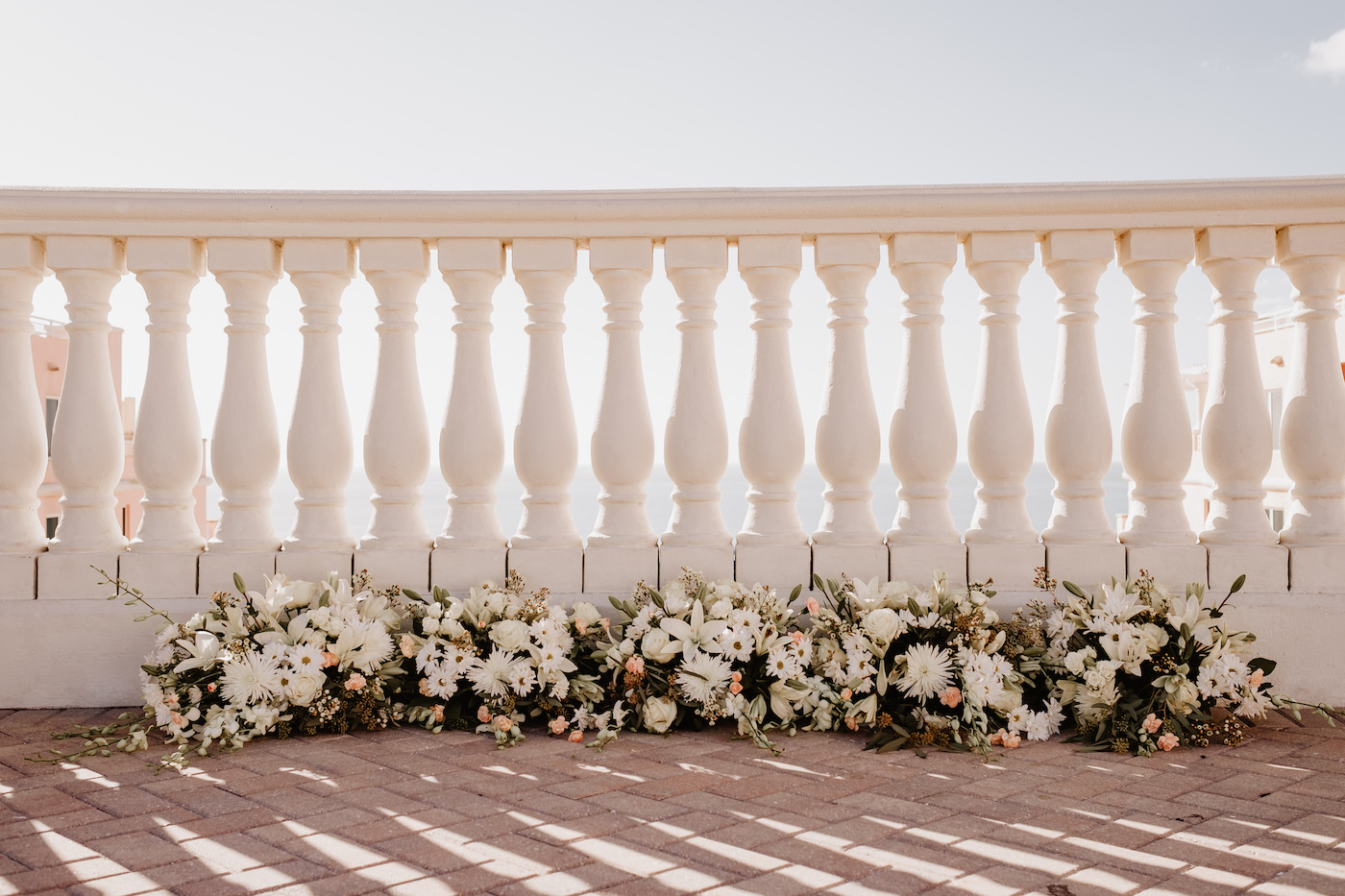 Wedding Ceremony Garland Flowers along the Ground   White Lilies and Chrysanthemums with Greenery