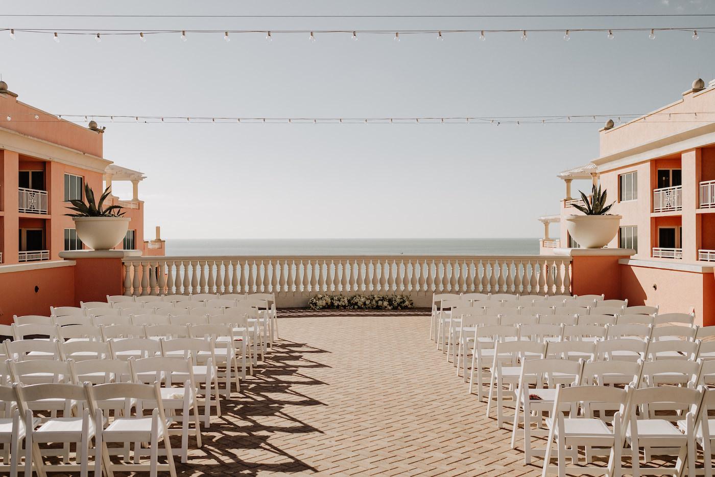 Clearwater Beach Wedding Venue Hyatt Regency Clearwater Beach Hotel   Outdoor Rooftop Waterfront Wedding Ceremony with White Garden Chairs