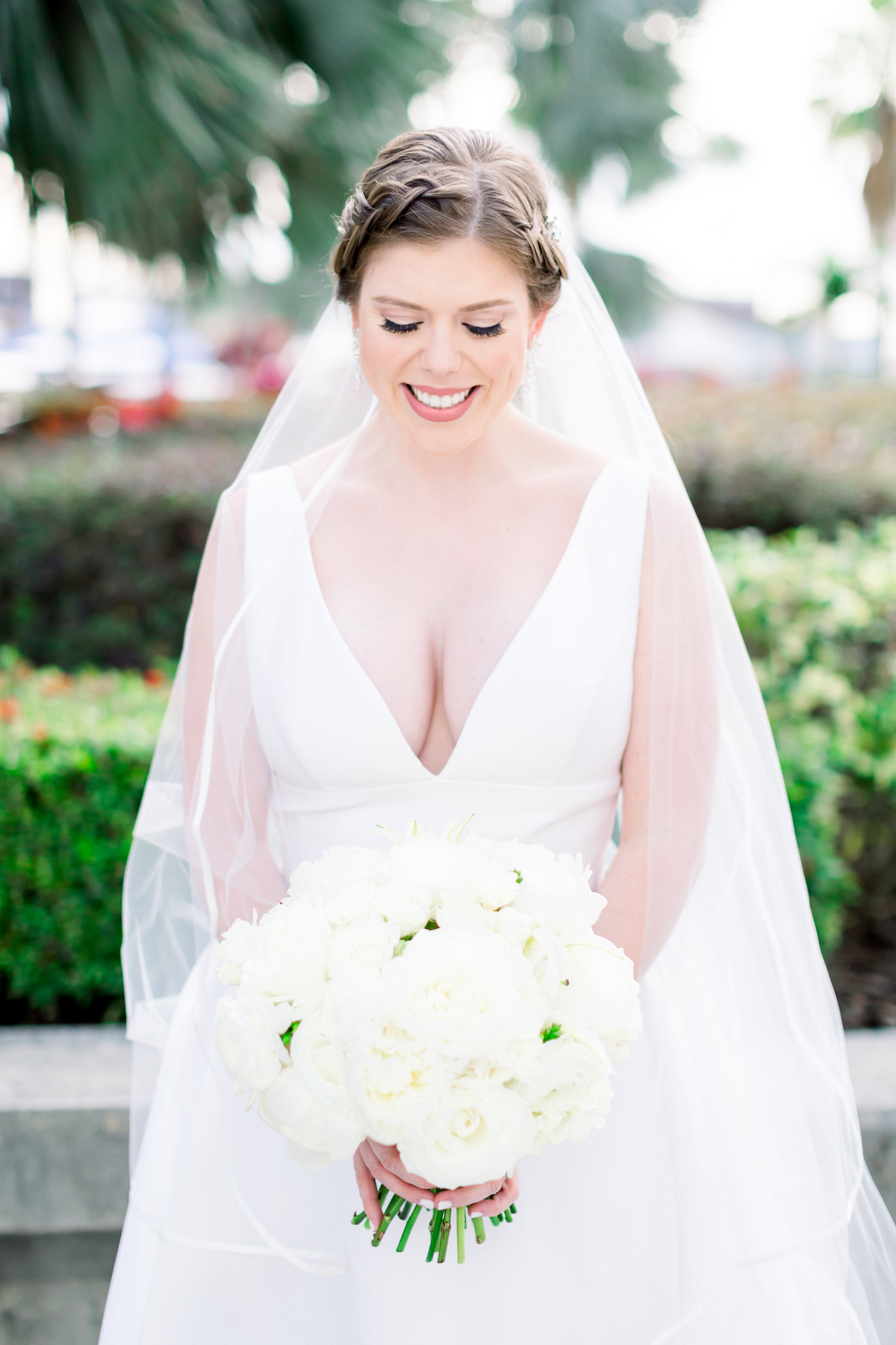 Classic Elegant Tampa Bride Beauty Portrait in Plunging V Neckline Ballgown Wtoo by Watters Wedding Dress Holding White Roses Floral Bouquet, Braided Updo, Long Veil | Wedding Photographer Shauna and Jordon Photography | Wedding Hair and Makeup Femme Akoi Beauty Studio | Wedding Planner UNIQUE Weddings + Events