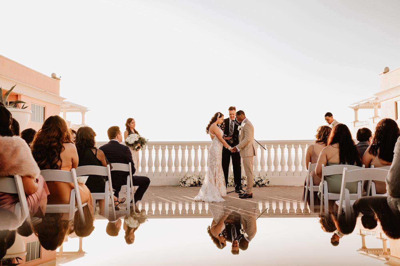 Clearwater Wedding Venue Hyatt Regency Beach Hotel   Outdoor Rooftop Waterfront Wedding Ceremony with White Garden Chairs