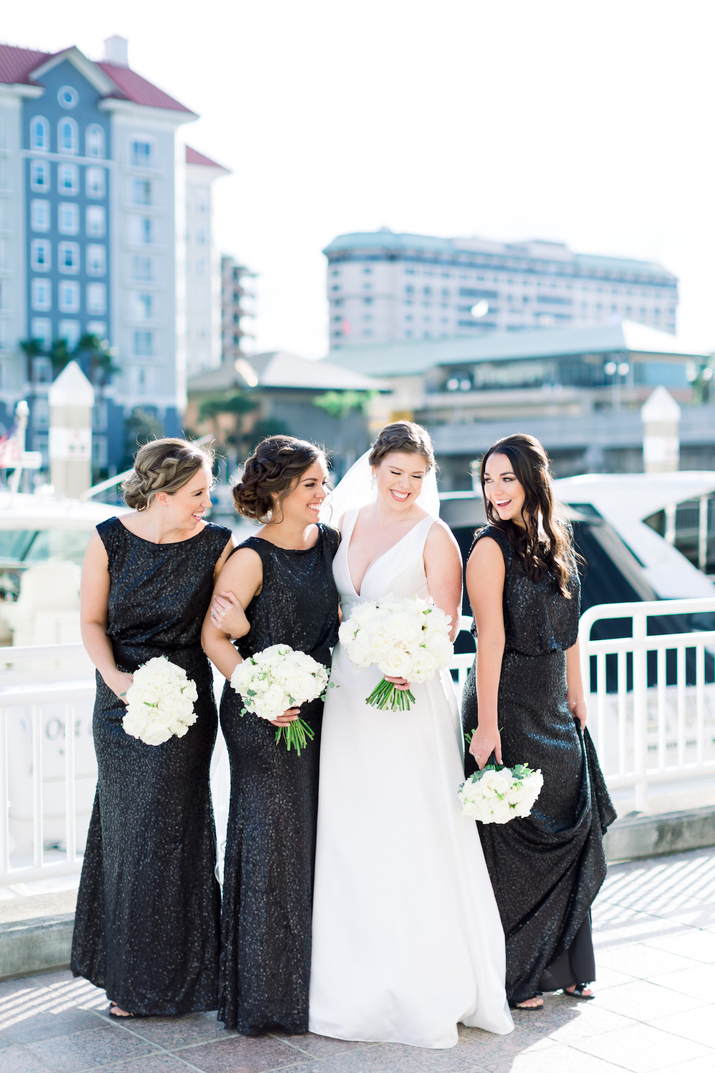 Classic Bride with Bridesmaids in Matching Black Dresses Holding White Floral Bouquets | Wedding Photographer Shauna and Jordon Photography | Tampa Wedding Planner UNIQUE Weddings + Events | Wedding Hair and Makeup Femme Akoi Beauty Studio