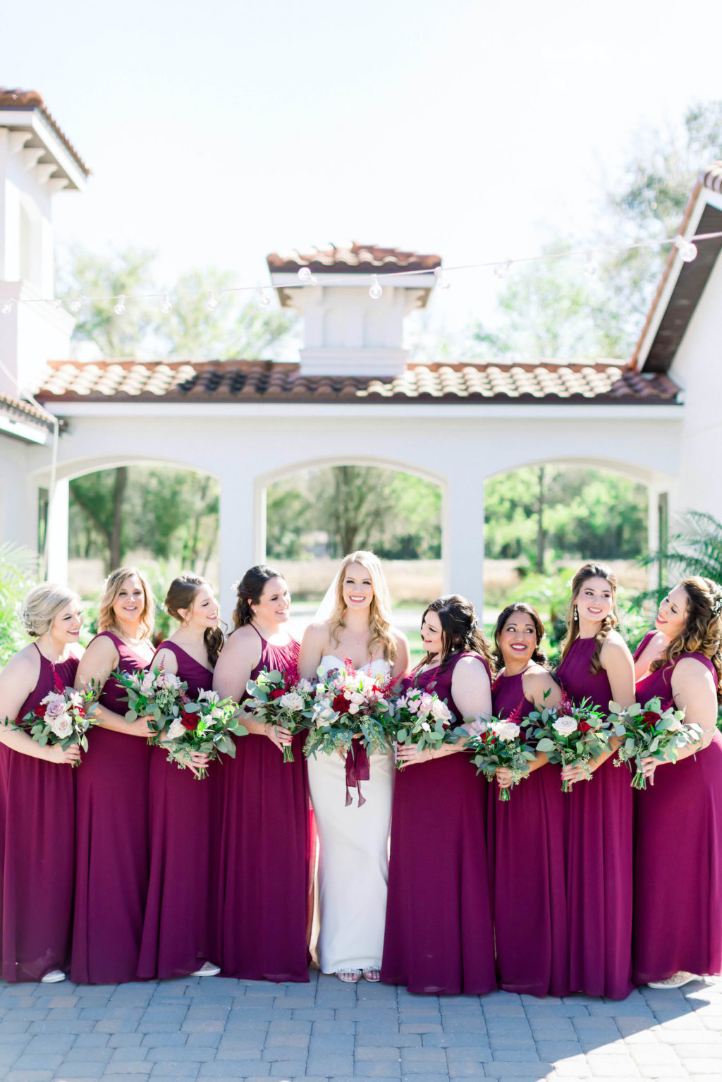 Burgundy Bordeaux Wine Deep Red Long Chiffon Bridesmaid Dresses | Outdoor Florida Wedding Bride and Bridesmaids Portrait | Burgundy and Blush Pink Bridal Bouquet with Roses and Astilbe and Eucalyptus Greenery | Shauna and Jordon Photography