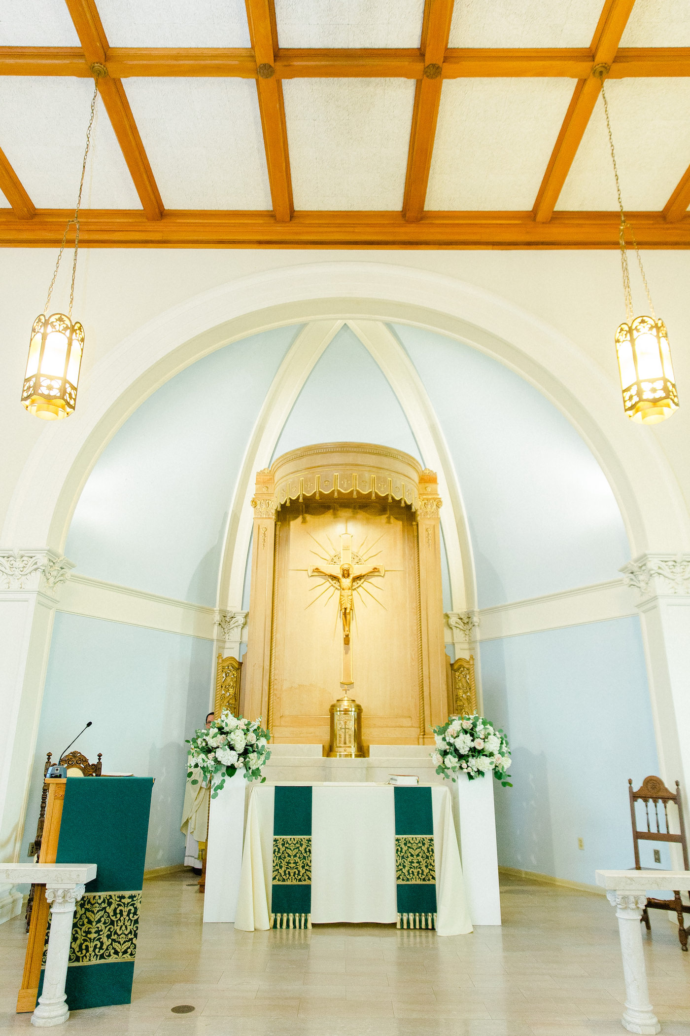 Traditional Florida Wedding Ceremony Inside Church, Catholic Ceremony Altar and Pulpit, Decorated with White, Ivory, and Blush Pink Flowers with Greenery | All Saints Academy in South Tampa | Tampa Bay Wedding Planner Breezin' Weddings