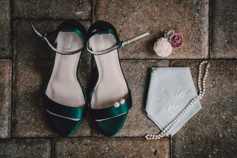Wedding Accessories Flat Lay Photo | Emerald Green Satin Wedding Bridal Shoes with Embroidered I Do Handkerchief and Pearls