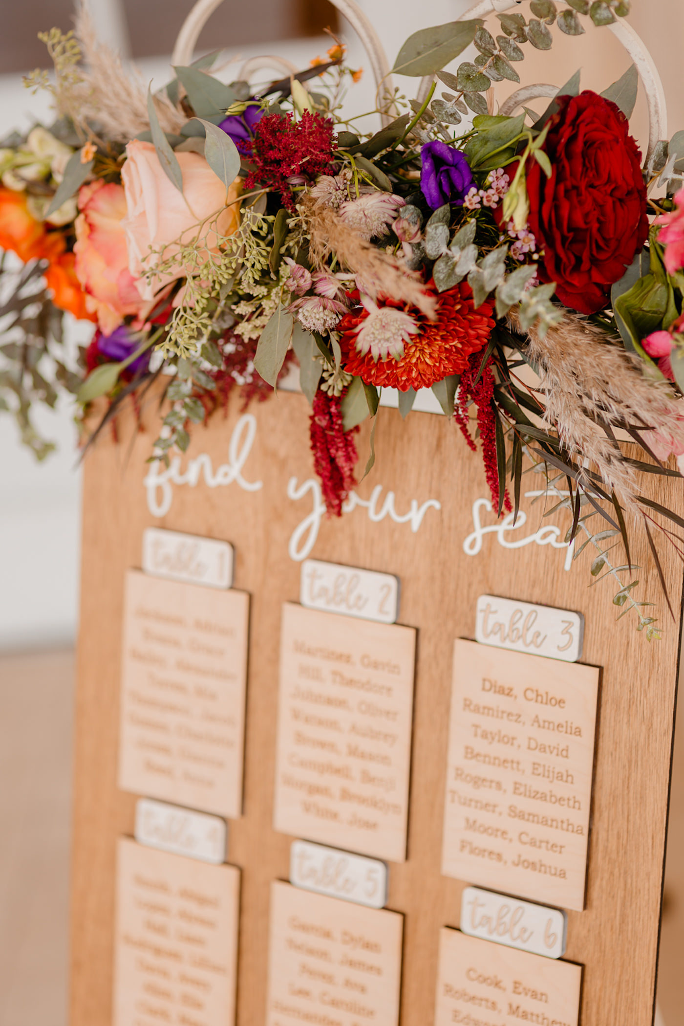 Boho Glam Wedding Inspiration | Etched Wood Seating Chart Unique Table Plan Alternative | Jewel Tone Floral Arrangement with Roses, Eucalyptus and Pampas Grass