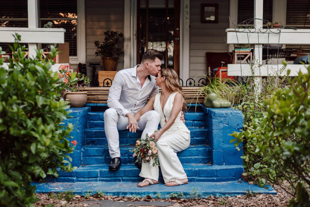 Bride and Groom Outdoor Wedding Portrait | COVID Wedding Elopement Backyard Ceremony | Ivory White Bridal Jumpsuit | Casual Groom White Shirt and Pants