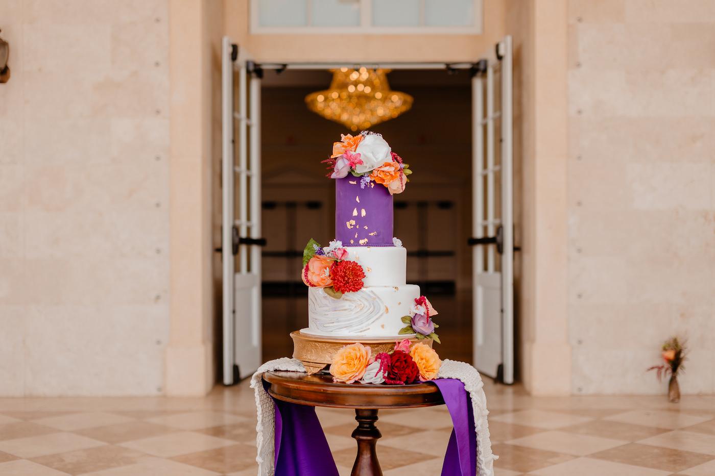 Boho Glam Wedding Cake | Three Tier Purple Marbled Fondant Wedding Cake with Golf Leaf Flecks and Jewel Tone Red and Orange Roses