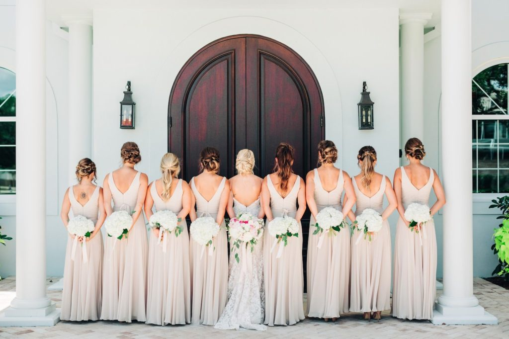 Outdoor Wedding Bridal Party Portrait | Neutral Nude Champagne Watters Bridesmaid Dresses from Bella Bridesmaid | White Hydrangea Bouquets with Cascading Ribbon | Champagne and Ivory Lace Sheath Spaghetti Strap Wedding Dress Bridal Gown with Low Back