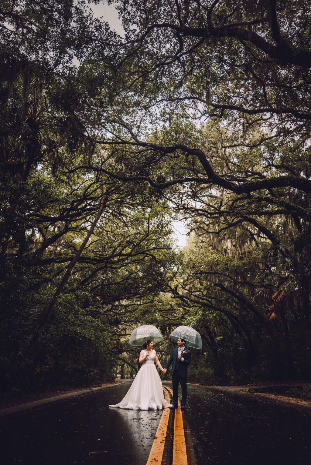 Bride and Groom Rainy Wedding Day Portrait with Clear Umbrellas | St. Petersburg Florida Wedding