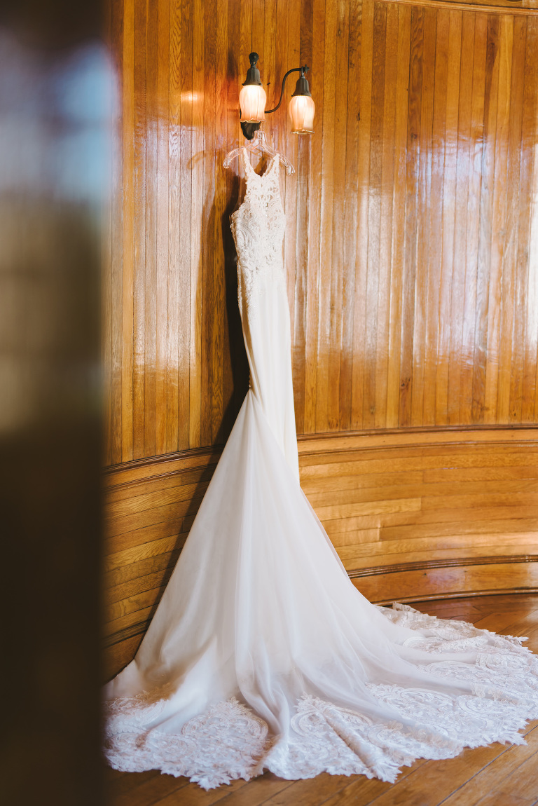 Romantic Lace Wedding Dress Hanging in Historic Powel Crosley Estate in Sarasota | Florida Wedding Photographer Kera Photography