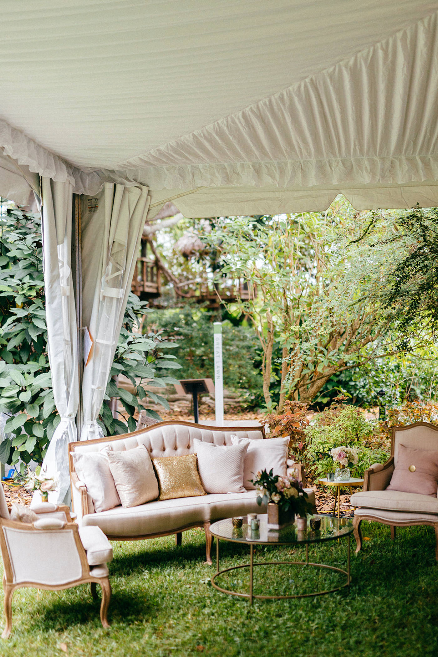 Romantic, Garden Inspired Wedding Reception Decor In Tented Outdoor Florida Wedding, Luxurious Lounge Chairs with Blush Pink Velvet, Elegant Arm Chairs, Gold Sequined Pillow Accents, Modern and Vintage Furniture   Sarasota Wedding Planner NK Weddings