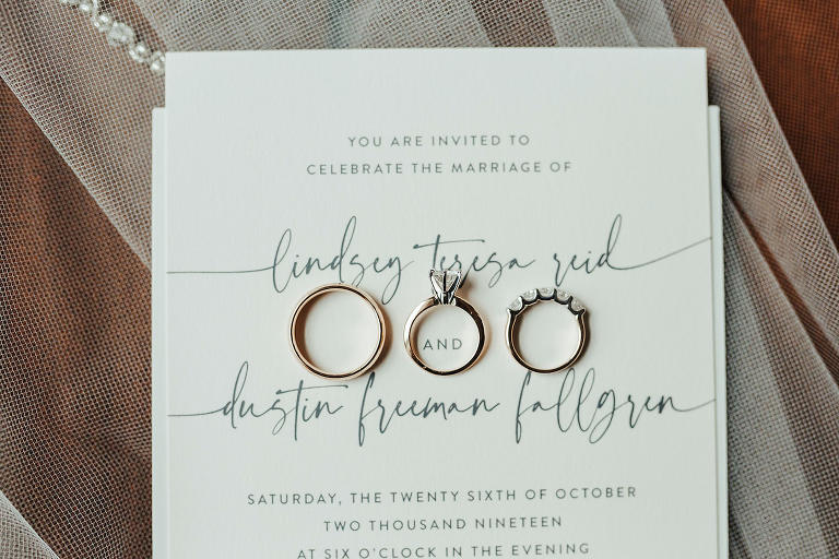 Classic White and Dark Gray Wedding Invitation with Modern Handwritten Font Script, Gold Wedding Bands and Engagement Ring